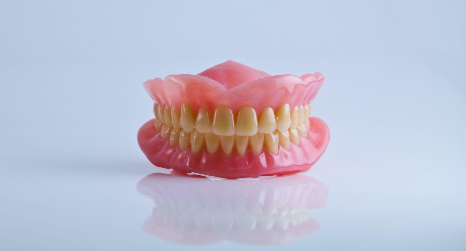 full set of acrylic denture isolated on white background